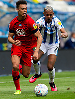 Huddersfield Town's Juninho Bacuna vies for possession with Wigan Athletic's Antonee Robinson<br /> <br /> Photographer Alex Dodd/CameraSport<br /> <br /> The EFL Sky Bet Championship - Huddersfield Town v Wigan Athletic - Saturday 20th June 2020 - John Smith's Stadium - Huddersfield <br /> <br /> World Copyright © 2020 CameraSport. All rights reserved. 43 Linden Ave. Countesthorpe. Leicester. England. LE8 5PG - Tel: +44 (0) 116 277 4147 - admin@camerasport.com - www.camerasport.com