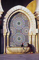 Casablanca, Morocco - Mother and Son at a Fountain at the Hassan II Mosque.