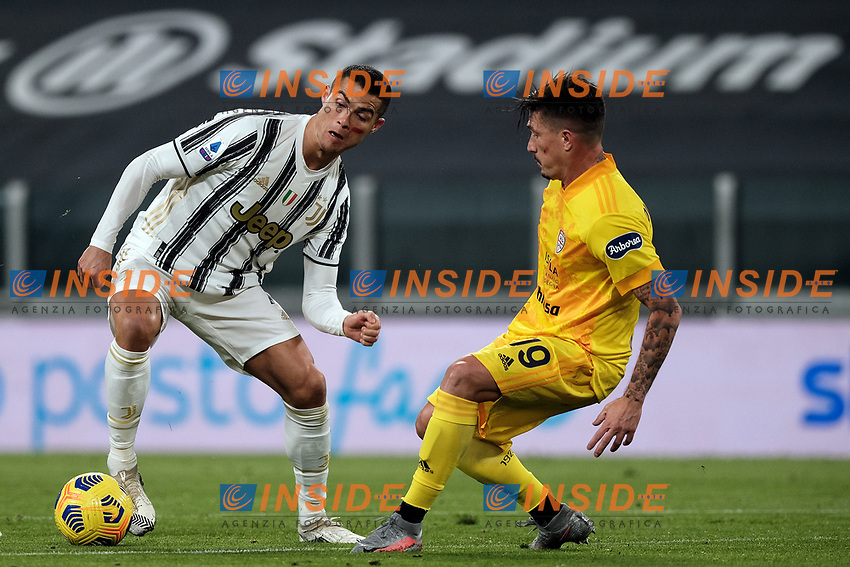 Cristiano Ronaldo of Juventus FC and Fabio Pisacane of Cagliari Calcio compete for the ball during the Serie A football match between Juventus FC and Cagliari Calcio at Allianz stadium in Torino (Italy), November21th, 2020. Photo Federico Tardito / Insidefoto