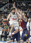 Real Madrid's Sergio Llull (l) and FC Barcelona's Ante Tomic during Euroleague match.February 5,2015. (ALTERPHOTOS/Acero)