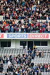 West Ham fans celebrate as Newcastle fans file out of the stadium. Newcastle v West Ham, August 15th 2021. The first game of the season, and the first time fans were allowed into St James Park since the Coronavirus pandemic. 50,673 people watched West Ham come from behind twice to secure a 2-4 win.