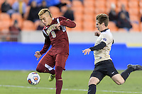 Houston, TX - Friday December 9, 2016: Andre Shinyashiki (9) of the Denver Pioneers takes a shot at the Wake Forest Demon Deacons goal in the first half of the  NCAA Men's Soccer Semifinals at BBVA Compass Stadium.