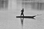 Fisherman checking his net, Luangwa River