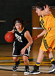JANUARY 23, 2015 -- Gabby Ramirez #21 of UC-Colorado Springs tries to drive around Dakota Barrie #32 of Black Hills State during their Rocky Mountain Athletic Conference women's basketball game Friday at the Donald E. Young Center in Spearfish, S.D.  (Photo by Dick Carlson/Inertia)