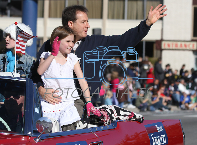 Lt Gov. Brian Krolicki and his daughter Elizabeth, 8, wave at the crowd during the Nevada Day parade on Saturday, Oct. 30, 2010, in Carson City, Nev. His daughter Caroline, 10, is at left..Photo by Cathleen Allison