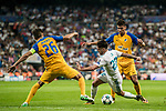 Isco Alarcon (c) of Real Madrid battles for the ball with Igor de Camargo (r) and Nuno Morais of APOEL FC during the UEFA Champions League 2017-18 match between Real Madrid and APOEL FC at Estadio Santiago Bernabeu on 13 September 2017 in Madrid, Spain. Photo by Diego Gonzalez / Power Sport Images