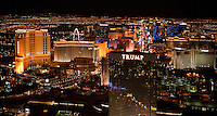 aerial photograph at night of Trump International Hotel, the Palazzo Tower at the Venitian Resort, the Mirage Hotel and Casino and other hotels and casinos in Las Vegas, Clark County, Nevada