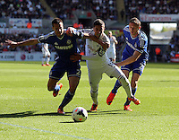 Sunday, 13 April 2014<br /> Pictured L-R: Pablo Hernandez of Swansea (C) is held back by Cesar Azpilicueta (L) and Nemanja Matic (R) of Chelsea<br /> Re: Barclay's Premier League, Swansea City FC v Chelsea at the Liberty Stadium, south Wales,
