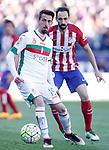 Atletico de Madrid's Juanfran Torres (r) and Granada Club de Futbol's Isaac Cuenca during La Liga match. April 17,2016. (ALTERPHOTOS/Acero)