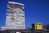 Bombed out government building stands adjacent to the newly renivated Holidat Inn. Sarajevo, Bosnia Herzegovina<br />