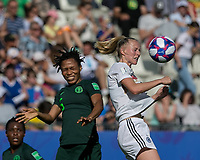 GRENOBLE, FRANCE - JUNE 22: Onome Ebi #5 of the Nigerian National Team, Lea Schueller #7 of the German National Team battle for head ball during a game between Nigeria and Germany at Stade des Alpes on June 22, 2019 in Grenoble, France.
