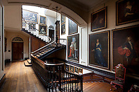 More elegantly wide staircases lead up to rooms on upper floors from the main stiarcase landing