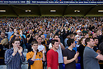 Birmingham City 1 Wolverhampton Wanderers 1, 01/05/2011. St Andrews, Premier League. Wolves supporters applauding their team at St. Andrew's stadium, at the final whistle of Birmingham City's Barclay's Premier League match with Wolverhampton Wanderers. Both clubs were battling against relegation from  England's top division. The match ended in a 1-1 draw, watched by a crowd of 26,027. Photo by Colin McPherson.