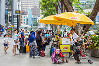 Singapore, Orchard Road Street Scene, Shoppers Buying Refreshments from Sidewalk Vendor.