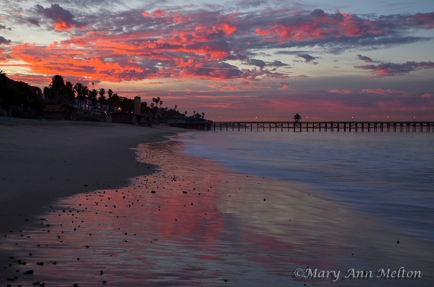 A rosy pink sunrise over the beach at San Clemente, California
