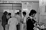 Gambling UK, Bookies betting shop Southfield west London.  Interior people placing bets on the horse. Horse racing. 1974, 1970s