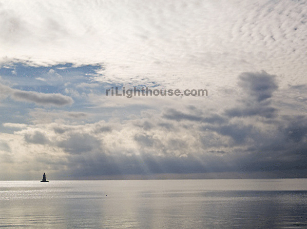 A storm approaches Sakonnet Point Lighthouse.