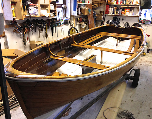 A beautifully-restored 14ft Rankin sailing dinghy. Being built with edge-glued clinker ply, they're remarkably light, and a 16ft version of this boat with the same beam but without the centreboard casing might make an ideal replacement for Red Rocket