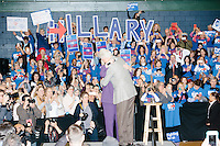 """Campaign volunteers hold up large letters spelling """"Hillary"""" as former president Bill Clinton embraces his wife, former Secretary of State and Democratic presidential candidate Hillary Rodham Clinton, before she speaks at a rally at Nashua Community College in Nashua, New Hampshire, on Tues. Feb. 2, 2016. Former president Bill Clinton also spoke at the event. The day before, Hillary Clinton won the Iowa caucus by a small margin over Bernie Sanders."""