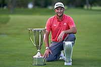 OLYMPIA FIELDS, ILLINOIS - AUGUST 30: Jon Rahm of Spain celebrates with the J.D. Wadley trophy and the BMW trophy after winning on the first sudden-death playoff hole against Dustin Johnson (not pictured) during the final round of the BMW Championship on the North Course at Olympia Fields Country Club