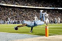CHAPEL HILL, NC - NOVEMBER 02: Dyami Brown #2 of the University of North Carolina dives into the end zone for his first touchdown during a game between University of Virginia and University of North Carolina at Kenan Memorial Stadium on November 02, 2019 in Chapel Hill, North Carolina.
