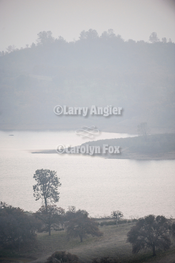 Haze and fog surround Pardee Reservoir in the Sierra Nevada Foothills of Calif.