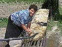 Armenia 2007 <br /> Yezidi woman washing sheep wool   <br /> Armenie 2007  <br /> Femme yezidi lavant de la laine de mouton