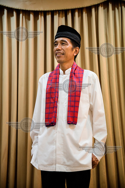 Indonesian President-elect, Joko Widodo, commonly known as Jokowi, poses for a portrait during an interview at his house in Jakarta.