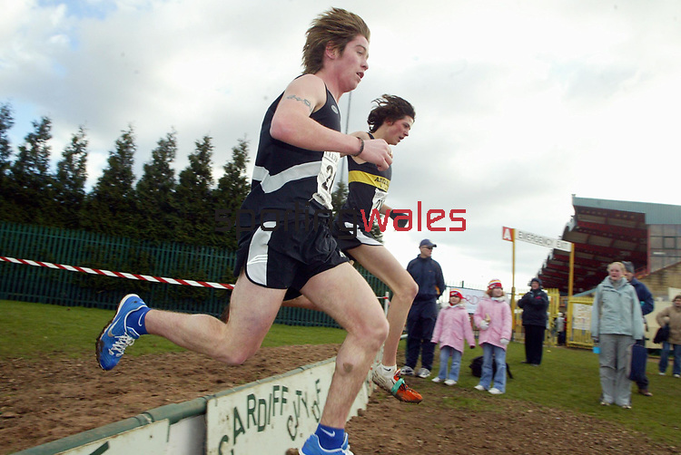 L-R: Afan Humphries (Cwmbran Harriers) & Matthew Williams (Aberdare AAC). <br /> Welsh Cross Country Championships<br /> Leckwith Stadium<br /> 20.02.05<br /> ©Steve Pope<br /> Sportingwales.com<br /> 07798 83 00 89<br /> The Manor <br /> Coldra Woods<br /> Newport<br /> South Wales<br /> NP18 1HQ