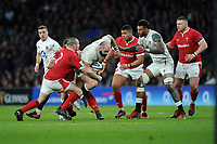 Joe Marler of England on the charge as Ken Owens of Wales attempts to halt his progress during the Guinness Six Nations match between England and Wales at Twickenham Stadium on Saturday 7th March 2020 (Photo by Rob Munro/Stewart Communications)