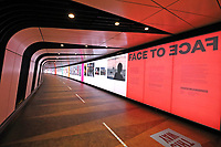 Face to Face is an exhibition of social documentary photography curated by Ekow Eshun, in partnership with the Fund for Global Human Rights. It is currently on display in the Kings Cross tunnel which runs under Coal Drops yard into the Rail Stations of St Pancras and Kings Cross in London. November 19th 2020<br /> <br /> Photo by Keith Mayhew