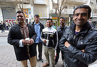 Pictured: Shehin Shah-Khan from Pakistan (L) with friends in Heyden Street, Victoria Square. Tuesday 08 March 2016<br /> Re: Migrants at Victoria Square, in central Athens, Greece.