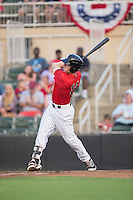 Max Dutto (14) of the Kannapolis Intimidators follows through on his swing against the Hagerstown Suns at Kannapolis Intimidators Stadium on July 4, 2016 in Kannapolis, North Carolina.  The Intimidators defeated the Suns 8-2.  (Brian Westerholt/Four Seam Images)