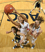 Nov. 14, 2010; Charlottesville, VA, USA; Virginia center Simone Egwu (4) grabs the rebound in front of Mount St. Mary's guard Ashley Christie (14) and Virginia forward Chelsea Shine (50) during the game at the John Paul Jones Arena. Virginia won 81-58. Mandatory Credit: Andrew Shurtleff-