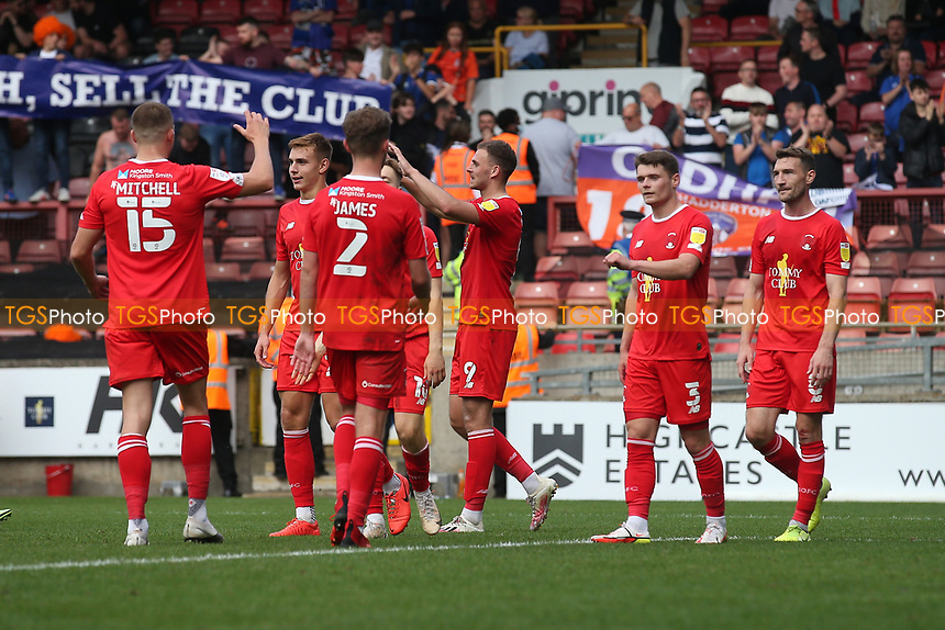 Harry Smith of Leyton Orient scores the fourth goal for his team and celebrates with his team mates during Leyton Orient vs Oldham Athletic, Sky Bet EFL League 2 Football at The Breyer Group Stadium on 11th September 2021
