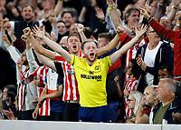 25th September 2021; Brentford Community Stadium, London, England; Premier League Football Brentford versus Liverpool; Brentford fans chanting at Liverpool fans