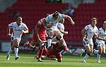 Guiness Pro12<br /> Ulster lock Franco Van Der Merwe hurdles past the diving tackle of Scarlets hooker Ken Owens<br /> Scarlets v Ulster<br /> Parc y Scarlets<br /> <br /> 06.09.14<br /> ©Steve Pope-SPORTINGWALES