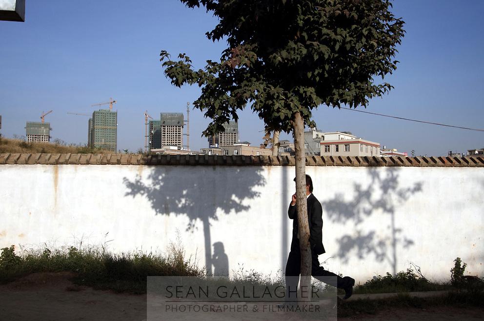 CHINA. New developments loom over Zijun village in Kunming, home of the Samatao minority. 2010