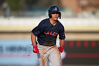 Nick Yorke (3) of the Salem Red Sox hustles towards third base against the Kannapolis Cannon Ballers at Atrium Health Ballpark on July 30, 2021 in Kannapolis, North Carolina. (Brian Westerholt/Four Seam Images)