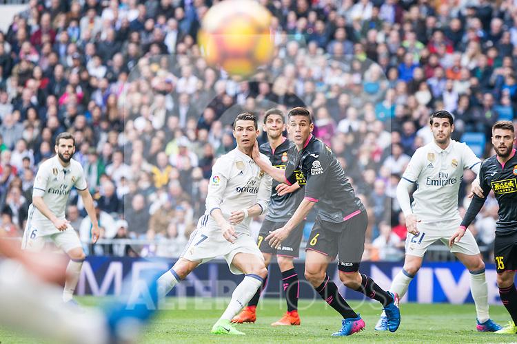 Cristiano Ronaldo of Real Madrid competes for the ball with Oscar Duarte of RCD Espanyol during the match of La Liga between Real Madrid and RCE Espanyol at Santiago Bernabeu  Stadium  in Madrid , Spain. February 18, 2016. (ALTERPHOTOS/Rodrigo Jimenez)