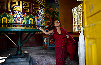 NEPAL Pokhara, tibetan refugee camp Tashi Ling, Shri Gaden Dhargyaling Monastery, young novice Lobsang Ngawang cirlce around prayer mill / tibetisches Fluechtlingslager Tashi Ling, Shri Gaden Dhargyaling Monastery, Junge Lobsang Ngawang, 11 Jahre, lebt seit 2012 im Kloster, stammt aus tibetischer Nomadenfamilie in Upper Mustang, dreht und umrundet Gebetsmuehle
