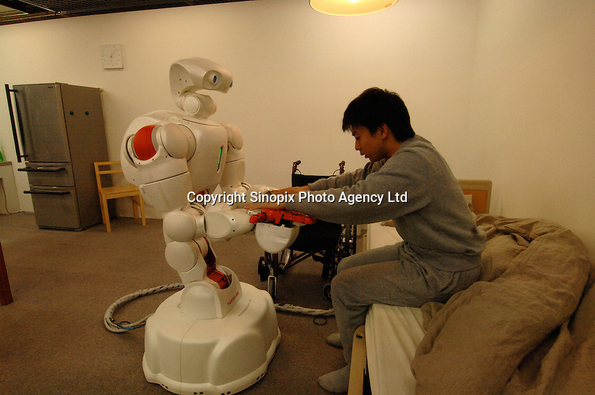 """The human symbiotic robot """"Twendy One"""" that is being developed to aid in labor shortages and in aging societies. The 1.5 meter tall and 111 kg heavy robot is able to assist lift a human and also is dextrous enough to massage."""