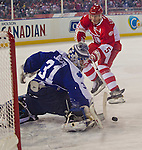 31 December 2013: Former Toronto Maple Leafs goalie Curtis Joseph (31) blocks a shot attempt from former Detroit Red Wings defenseman Nicklas Lidstrom (5) during the Toronto Maple Leafs v Detroit Red Wings Alumni Showdown hockey game, at Comerica Park, in Detroit, MI.