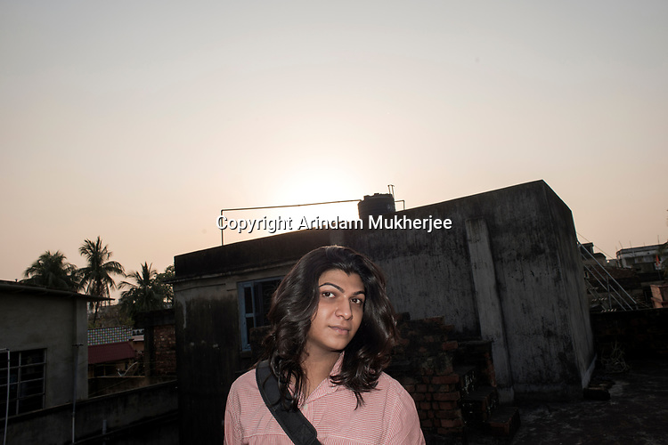 Dipmalya (Diya) on the rooftop of his house where he used to spent his lonely afternoons after he was abused by on of his family members, Kolkata, India. Arindam Mukherjee