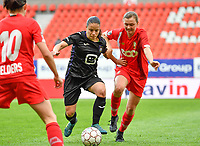 Stefania Vatafu (10) of Anderlecht pictured fighting for the ball with Yuna Appermont (6) of Standard  during a female soccer game between Standard Femina de Liege and RSC Anderlecht on the 8th matchday in play off 1 of the 2020 - 2021 season of Belgian Scooore Womens Super League , tuesday 18 th of May 2021  in Angleur , Belgium . PHOTO SPORTPIX.BE | SPP | DAVID CATRY