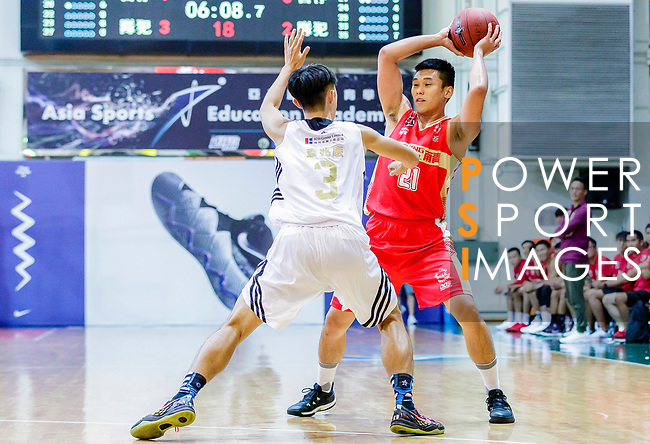 Wong Tsz Him #21of Nam Ching Basketball Team handles the ball against the Eagle during the Hong Kong Basketball League game between Eagle and Nam Ching at Southorn Stadium on June 22, 2018 in Hong Kong. Photo by Yu Chun Christopher Wong / Power Sport Images