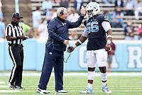 CHAPEL HILL, NC - OCTOBER 10: Head coach Mack Brown of North Carolina encourages Tomari Fox #56 during a game between Virginia Tech and North Carolina at Kenan Memorial Stadium on October 10, 2020 in Chapel Hill, North Carolina.