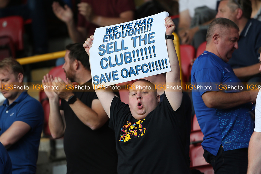 An Oldham fan with a We've Had Enough! Sell the Club! banner during Leyton Orient vs Oldham Athletic, Sky Bet EFL League 2 Football at The Breyer Group Stadium on 11th September 2021