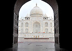 View of the Taj Mahal through doorway in Agra, India.