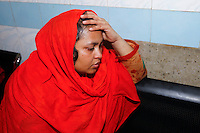 Shilpi, sister of Oyasiqur Rahman Babu, mourns for her brother at Dhaka Medical College Hospital. Bangladeshi blogger Oyasiqur Rahman Babu hacked to death today around 9:45am at the Tejgaon Indsutrial area in Dhaka, Bangladesh, March 30, 2015. Two madrasa students have been detained with sharp weapons for suspected involvement with the murder. Three meat cleavers have been recovered from the spot. This assassination follows a similar murder of blogger-writer Avijit Roy on Feb 25 at the Dhaka University campus. The two arrested for suspected involvement are  'Zikrullah', a Chittagong madrassa student ,  and Arif', a student of  a madrasa in Dhaka's Mirpur area, according to police.
